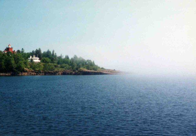 Two Harbors, with the lighthouse and pilot house and fog off Lake Superior